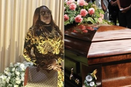 Viral photo of the corpse of a woman standing majestically at her own funeral